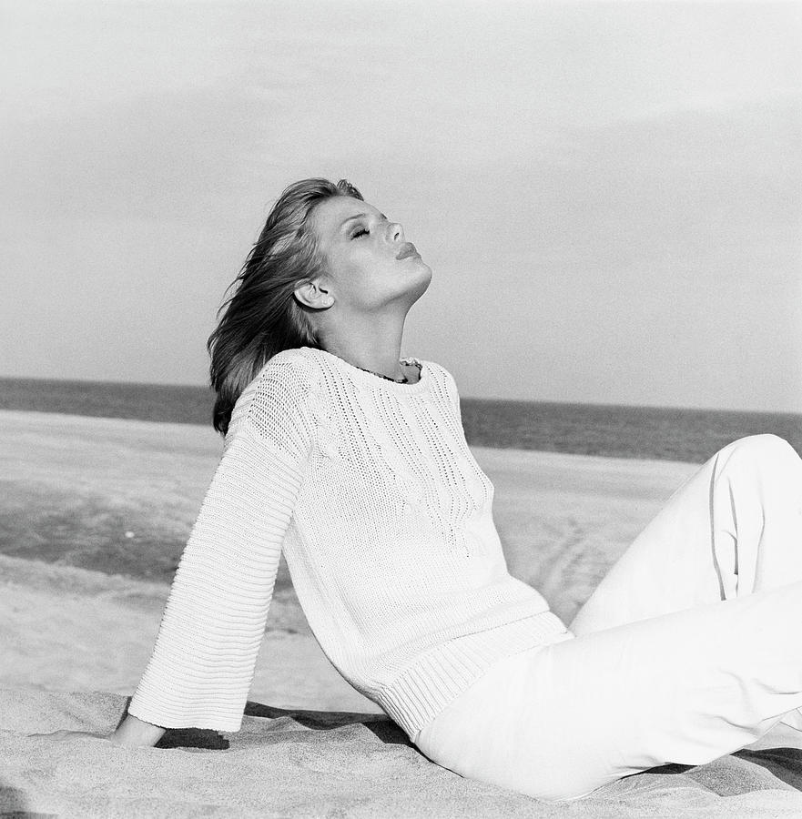 Patti Hansen Reclining on the Beach Photograph by Francesco Scavullo
