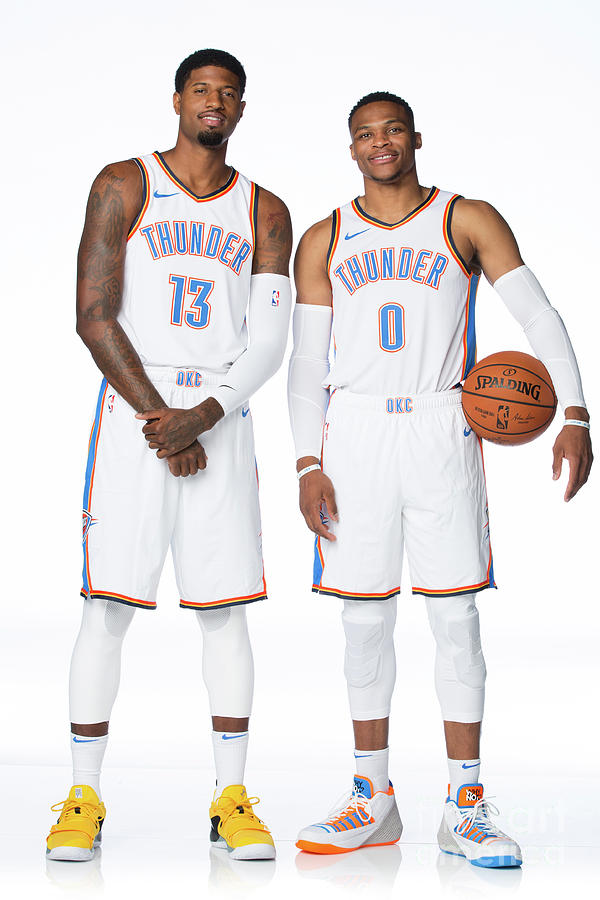 Paul George and Russell Westbrook Photograph by Nba Photos