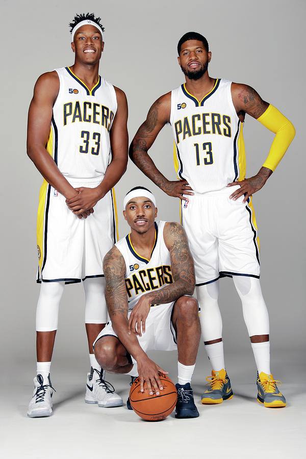 Paul George, Myles Turner, and Jeff Teague Photograph by Ron Hoskins