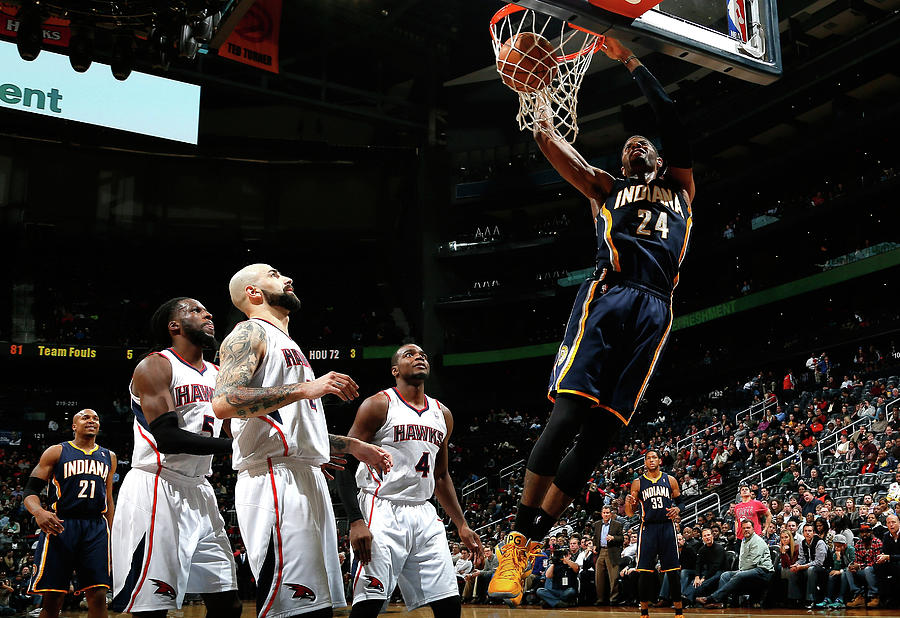 Paul George, Paul Millsap, and Demarre Carroll Photograph by Kevin C. Cox