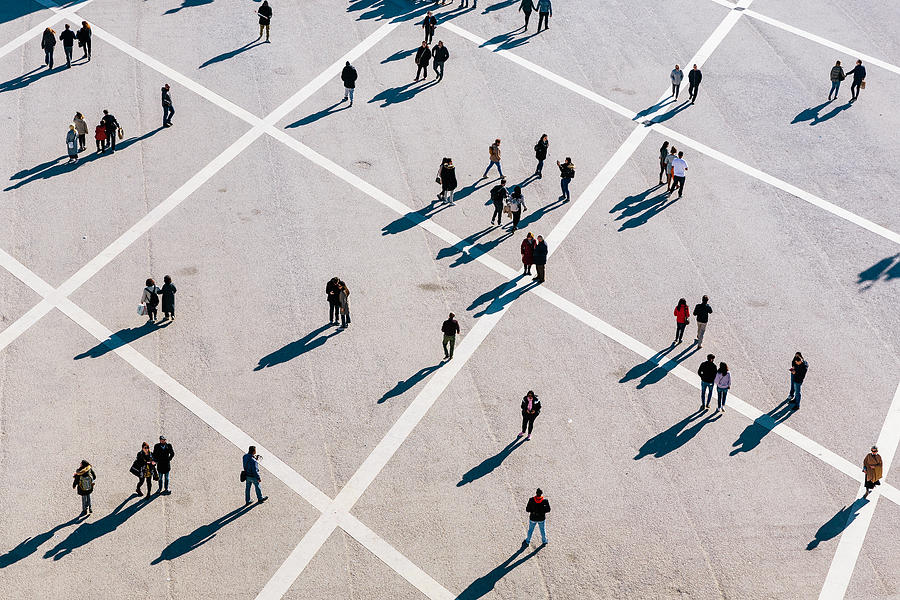 People walking at the town square on a sunny day Photograph by Alexander Spatari