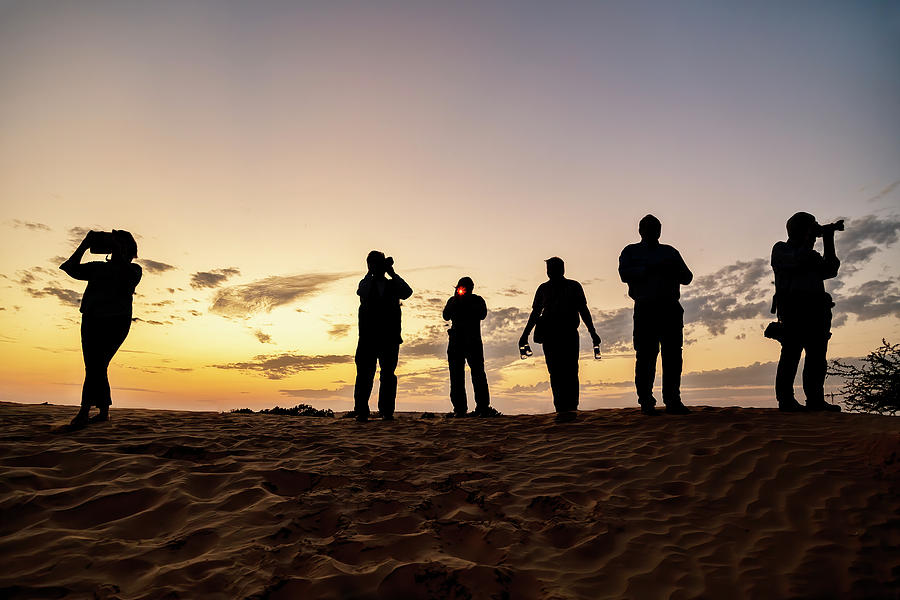 Photographers On the Dunes by Kay Brewer