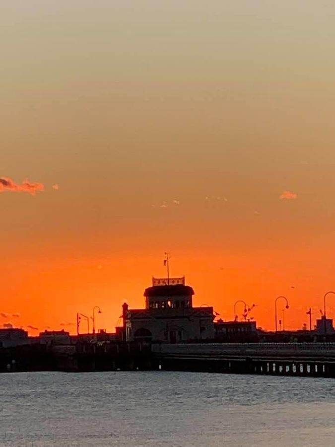 Pier cafe on fire with sunset Photograph by Gary Wohlman
