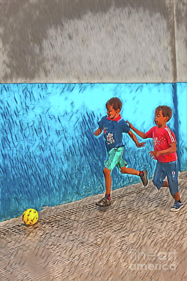 Playing Soccer On The Street Photograph