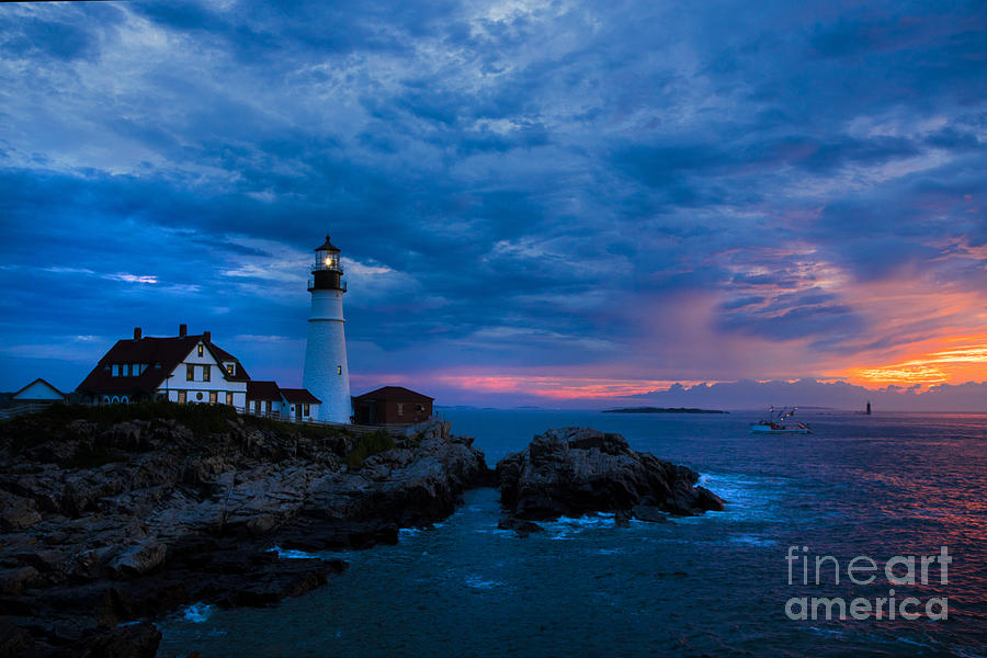 Portland Head Lighthouse With Fishing Boat. Photograph