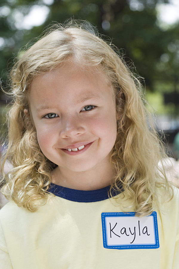 Portrait of a girl with name tag Photograph by Image Source