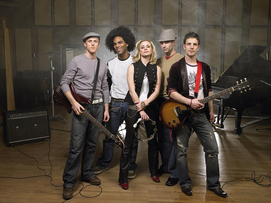 Portrait of a rock band Photograph by Image Source