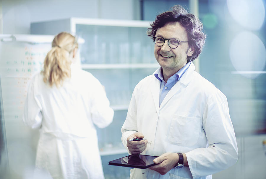 Portrait of a Scientist in a Modern Laboratory Photograph by Sanjeri