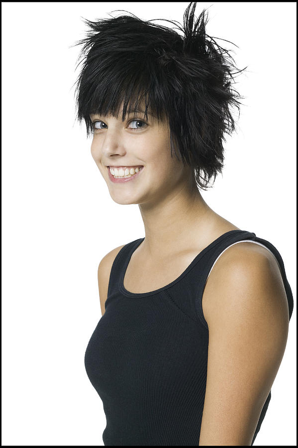 Portrait Of A Teenage Girl In A Black Tank Top As She Turns And Smiles Into The Camera Photograph by Photodisc