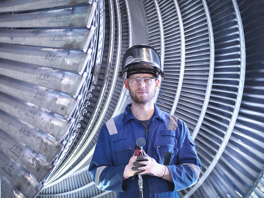 Portrait of apprentice engineer in steam turbine repair workshop Photograph by Monty Rakusen