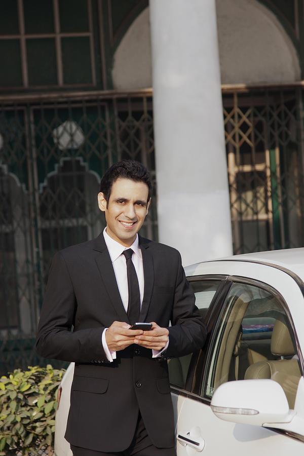 Portrait of businessman with mobile phone , INDIA , DELHI Photograph by Sudipta Halder