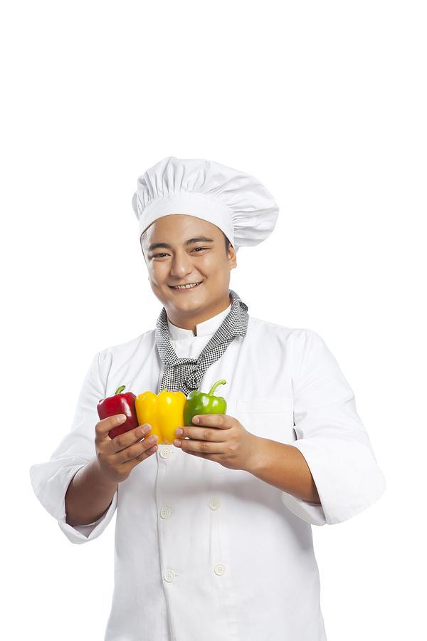 Portrait of chef holding capsicum Photograph by Ravi Ranjan
