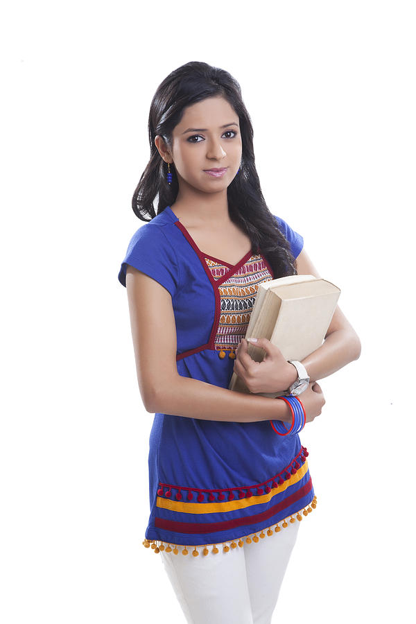 Portrait of college girl with book Photograph by IndiaPix/IndiaPicture