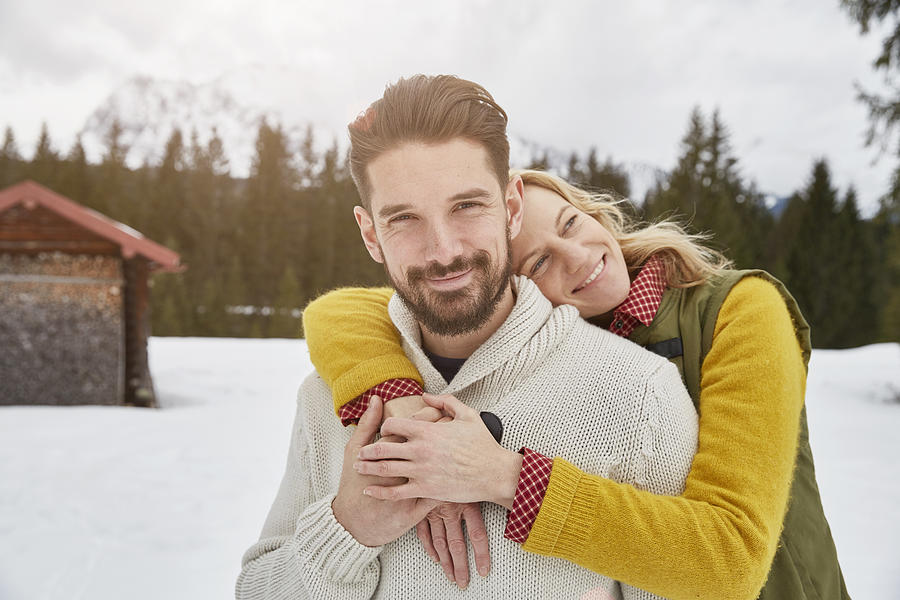 Portrait of romantic couple in snow, Elmau, Bavaria, Germany Photograph by Stephen Lux