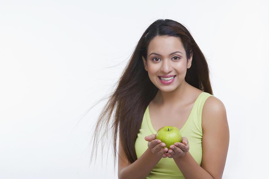 Portrait of woman holding an apple Photograph by Sudipta Halder