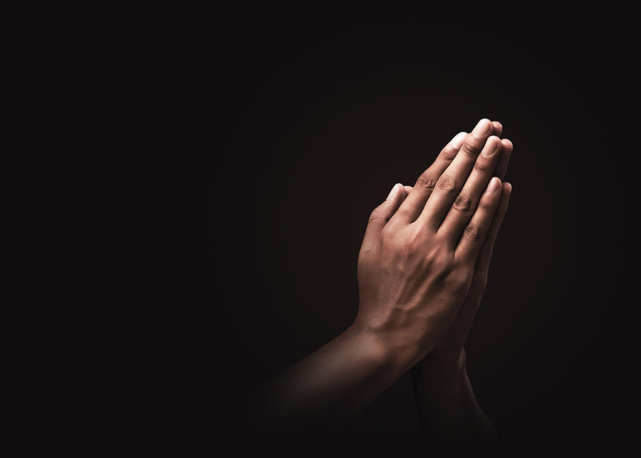 Praying hands with faith in religion and belief in God on dark background. Power of hope or love and devotion. Namaste or Namaskar hands gesture. Prayer position. Photograph by Lemon_tm