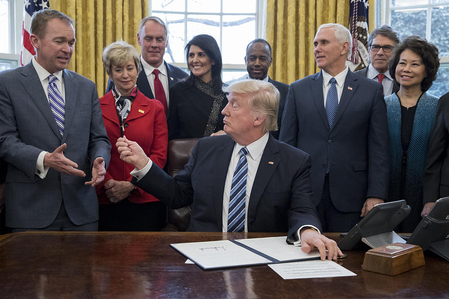 President Trump Signs Executive Order In Oval Office Photograph by Pool