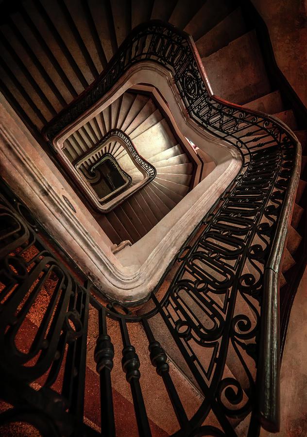Pretty abandoned brown staircase by Jaroslaw Blaminsky