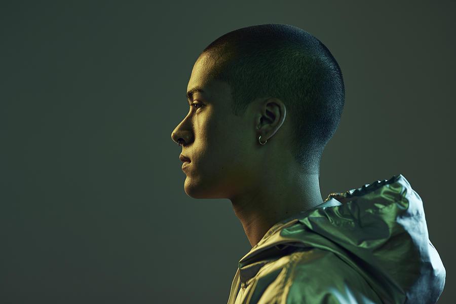 Profile shot of beautiful young man, shot on studio Photograph by Klaus Vedfelt