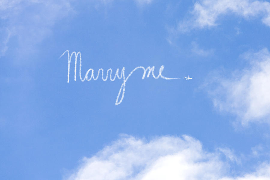 Proposal written in vapour trail Photograph by Image Source