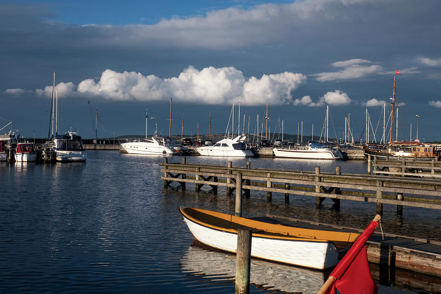 Pure White Clouds Boats And Grey Sky Photograph