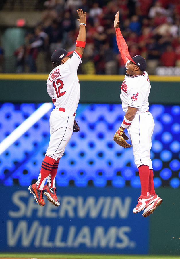 Rajai Davis and Francisco Lindor Photograph by Michael Ivins/boston Red Sox