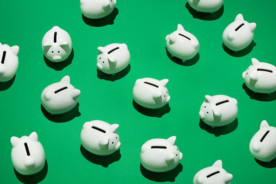 Random little white piggy banks Photograph by PM Images