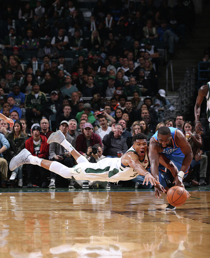 Raymond Felton and Giannis Antetokounmpo Photograph by Gary Dineen