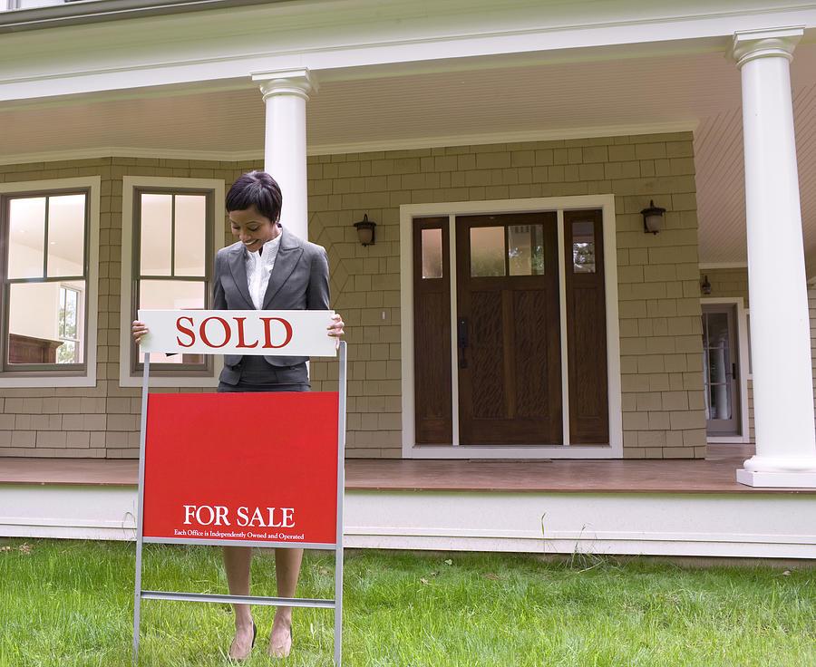 Realtor with sale sign Photograph by David Sacks