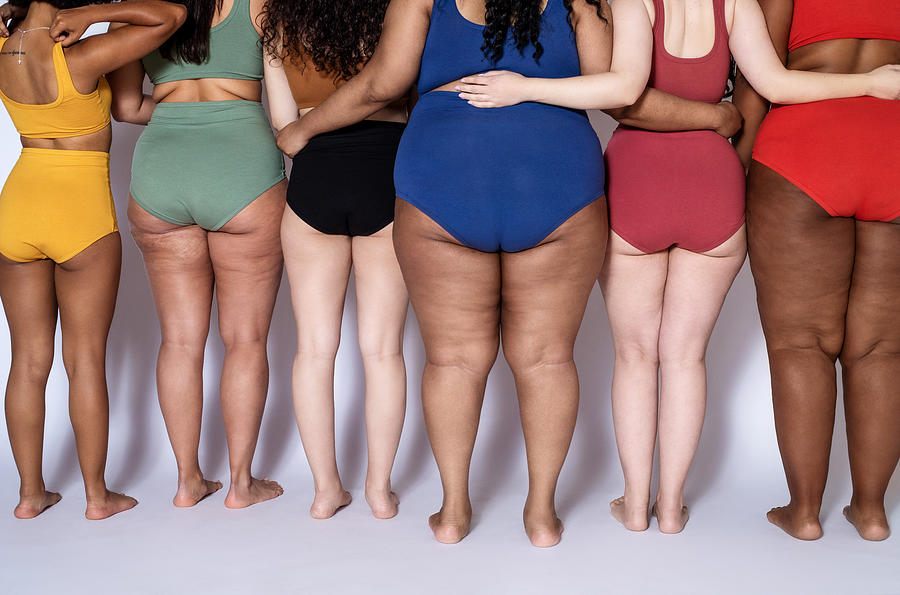 Rear view of a diverse females together in underwear Photograph by Luis Alvarez