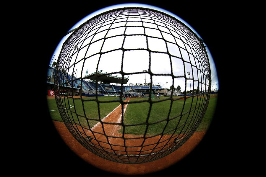 Rectangular Protective Baseball Screen In Use During Batting Practice. Photograph