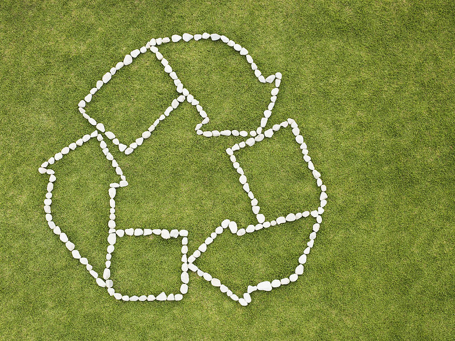 Recycling symbol made of rocks Photograph by Martin Barraud