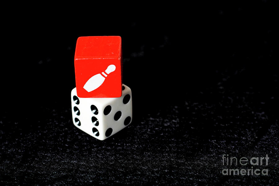 Red and White Dice on black background by Bridget Mejer