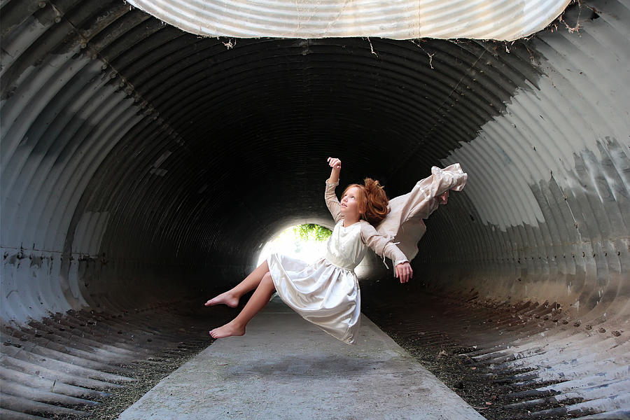 Red haired girl floating in tunnel Photograph by Dianne Avery Photography