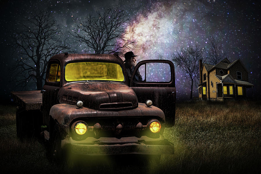 Red Truck at Night with Person and Rural Farm House on the Prari by Randall Nyhof