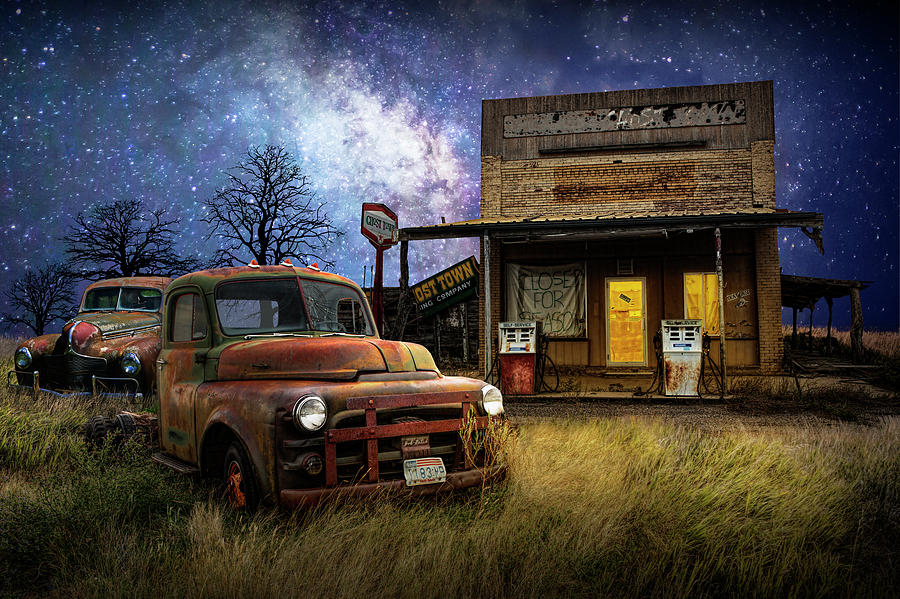 Red Truck by an Old Gas Station under the Starry Milkyway Sky by Randall Nyhof
