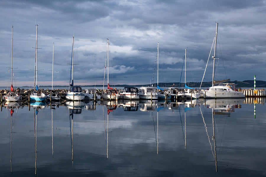 Reflexions In Still Harbor Water Photograph