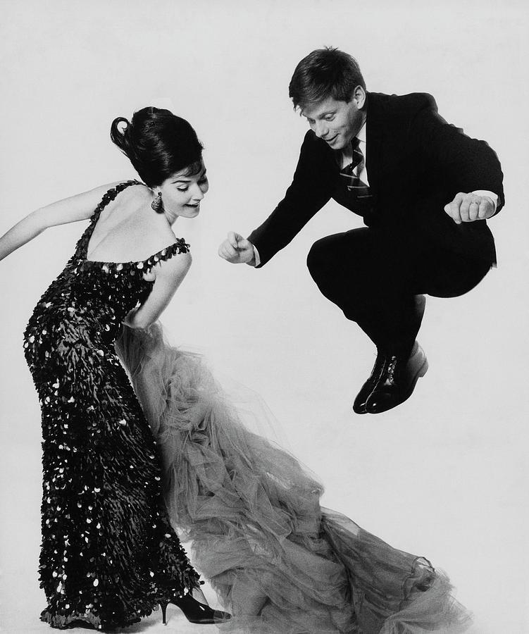 Robert Morse Jumping Over Donna Sanderss Gown Photograph by Bert Stern