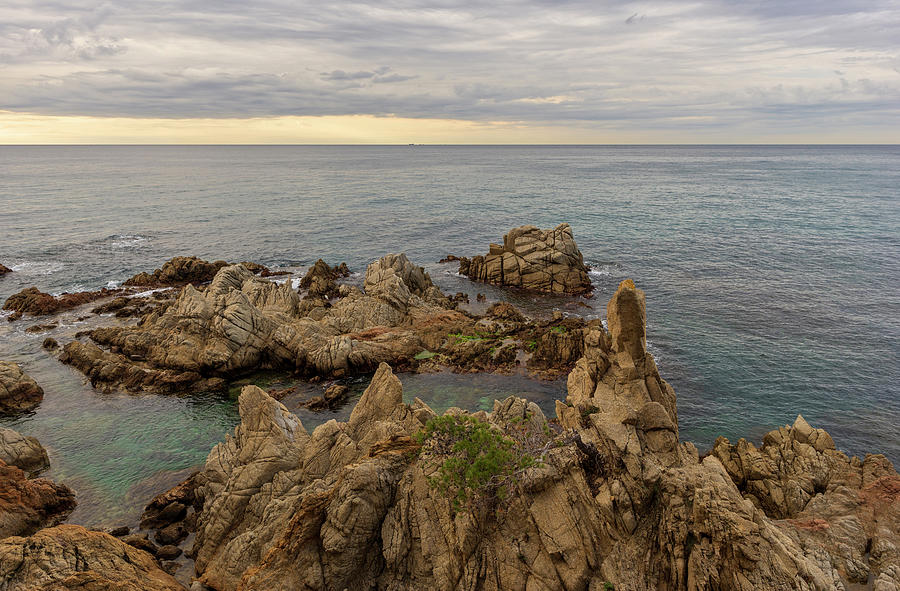 Lloret Photograph - Rocks In The Sea Of Lloret De Mar by Vicen Photography