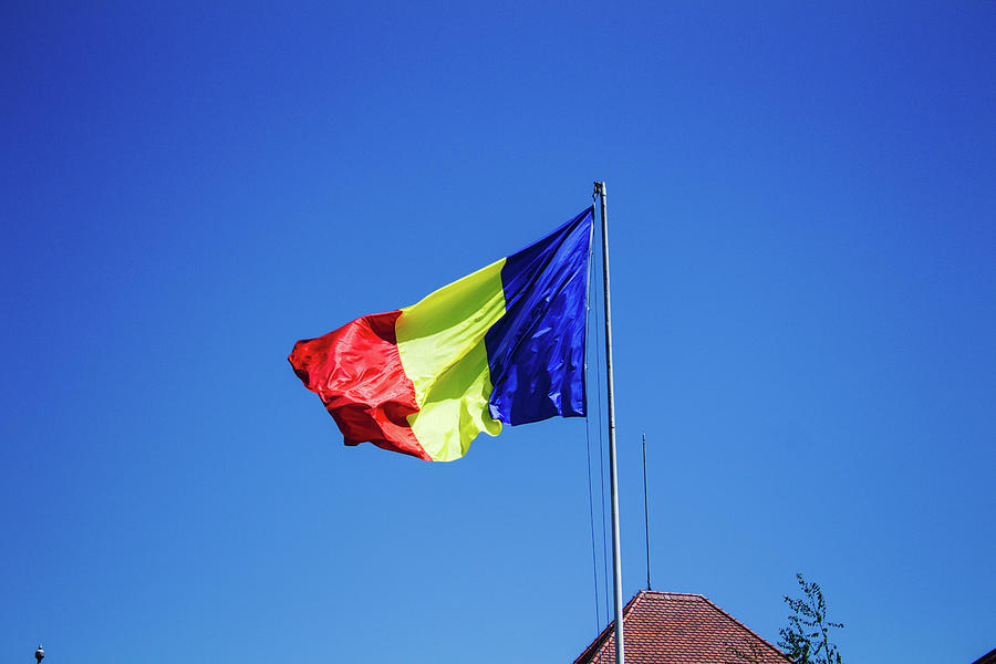 Romanian Flag In The Wind Seen From Bellow Photograph