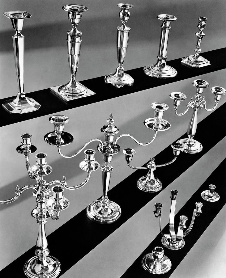 Rows Of Silver Candlesticks And Candelabras Photograph by Peter Nyholm