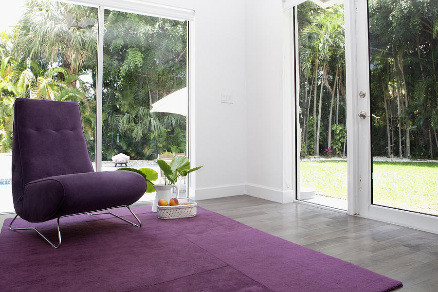 Rug, chair and windows in modern living room Photograph by Camilo Morales