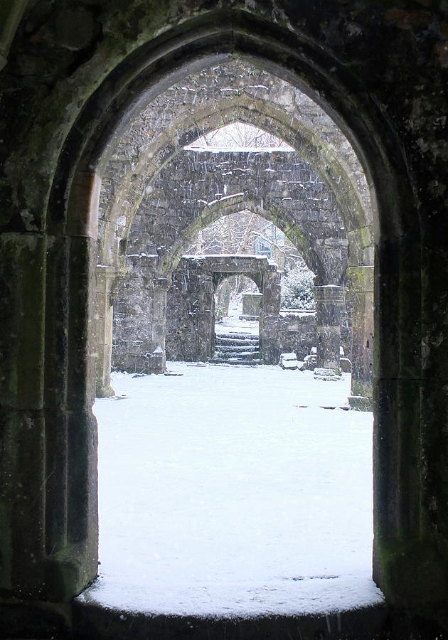 ruined arches and snowfall by Philip Openshaw