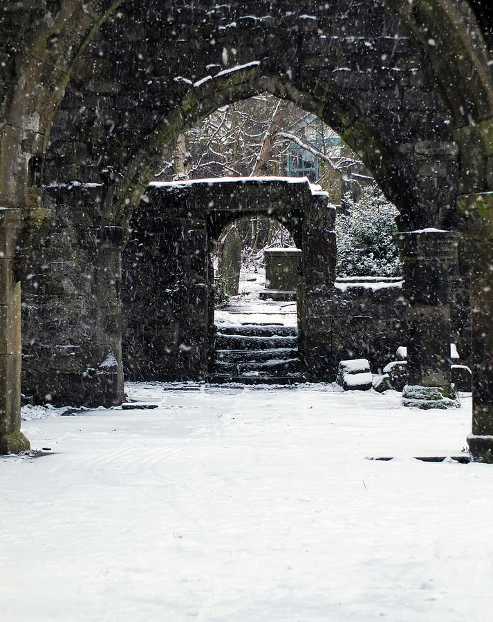 ruined church in snowfall by Philip Openshaw