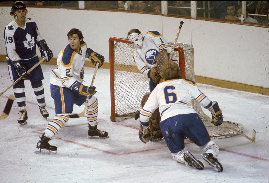 Sabres Defend Their Net Against The Leafs Photograph by Melchior DiGiacomo