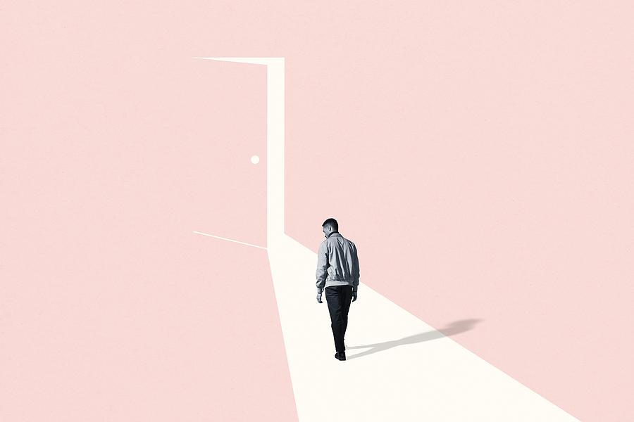 Sad young man walking towards ajar door Photograph by Klaus Vedfelt