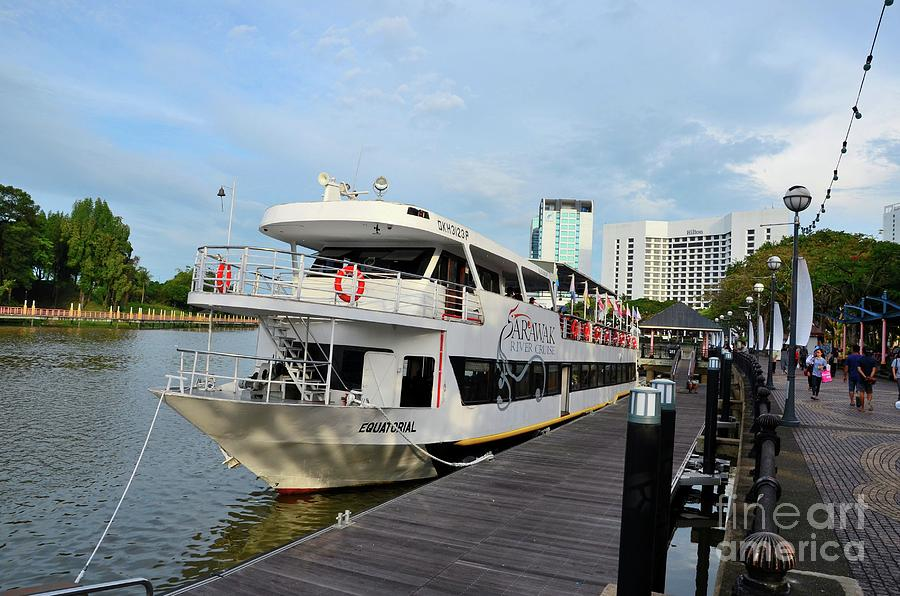 Sarawak River cruise tourism boat ferry with passengers awaits departure Kuching Malaysia by Imran Ahmed