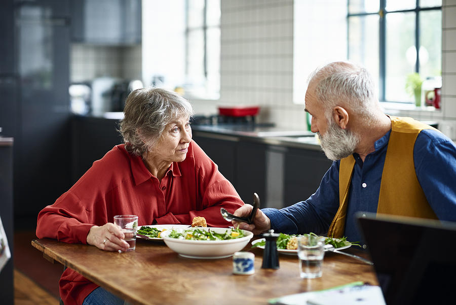 Senior couple having serious discussion over lunch at home Photograph by 10000 Hours
