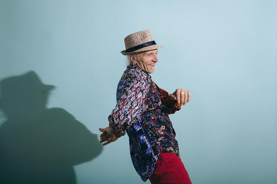 Senior Gay Man in Colorful Shirt Dancing Photograph by Willie B. Thomas