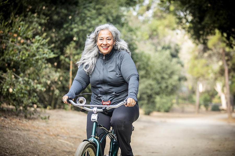 Senior Mexican Woman Riding Bicycle Photograph by Adamkaz